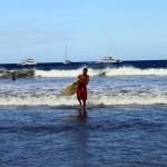 Logan enjoying an early morning surf