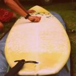 Logan readies his board